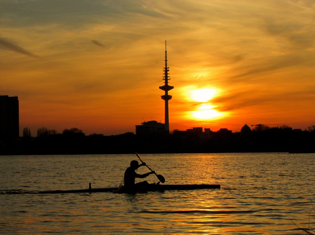 Relaxed canoe trip on the Alster in the sunset.