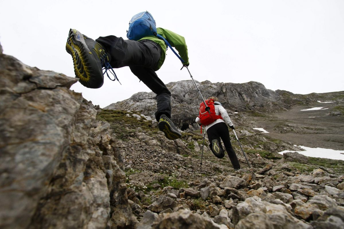 Speed Hiking on the Rothaarsteig Trail - Two speedhikers sprinting uphill.