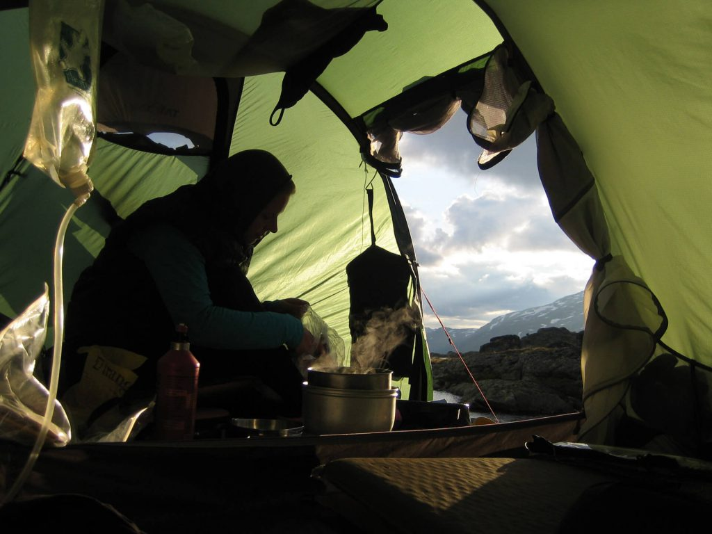 Cooking in the apse while camping in the wild.