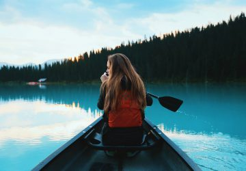 Basic paddling skills in Canada - woman in a boat on a lake.