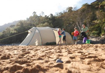 Camping with Children - Family with tent on the beach.