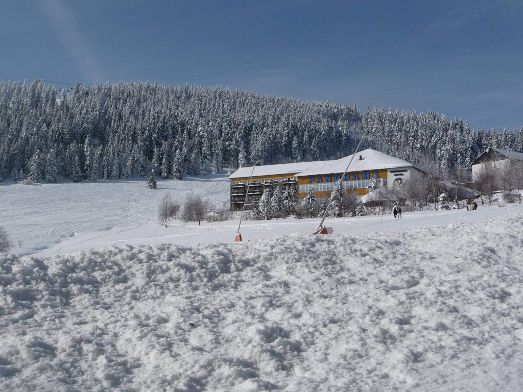 Snow-covered Panorama hotel in Oberwiesenthal in the Ore Mountains.