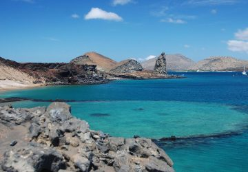 Trip to Galapagos - turquoise blue sea and rocky coast.