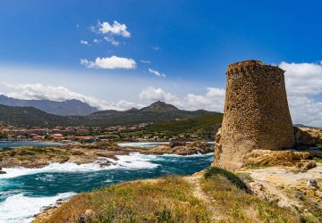 Hiking Corsica and Sardinia - Fortress with city and sea in the background on Corsica.