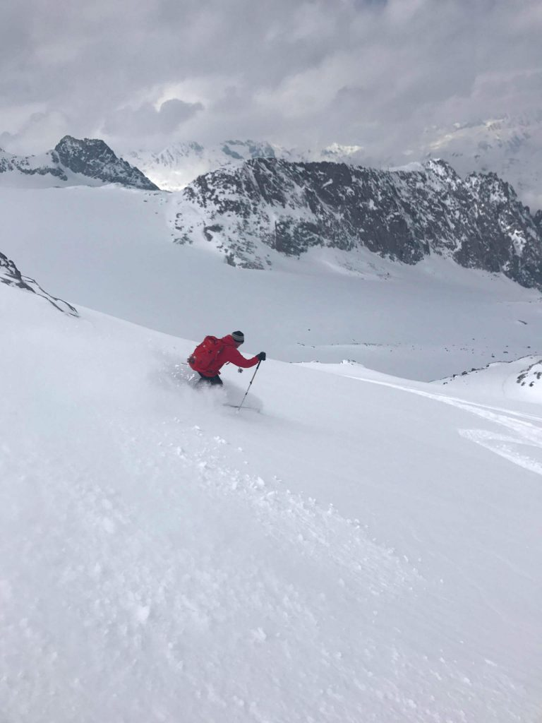 A ski tourer descending from a mountain.