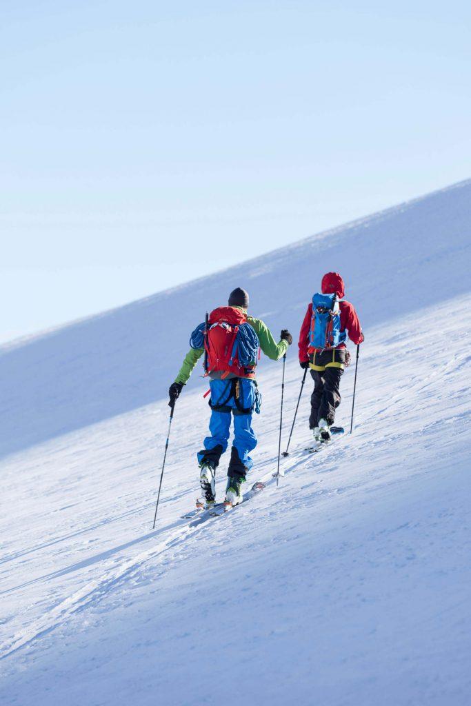 Two ski tourers on their way up.