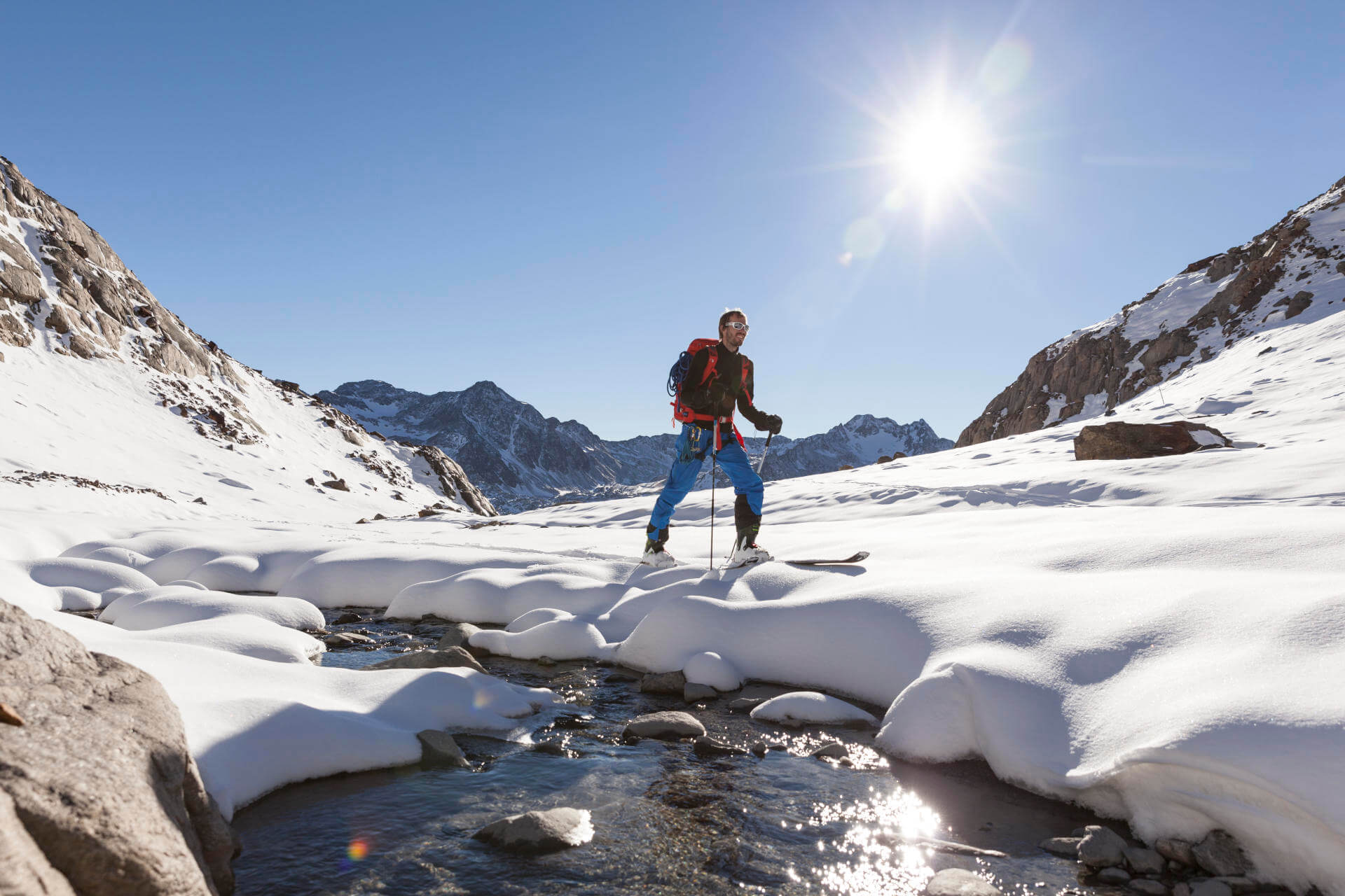 Ski touring for beginners - Ski tourer in the sunshine in the mountains.