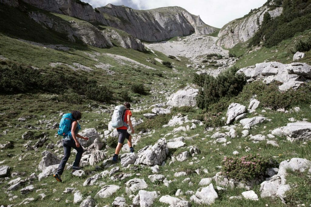 Hut tours in the alps - Two hikers with touring backpacks in the mountains.