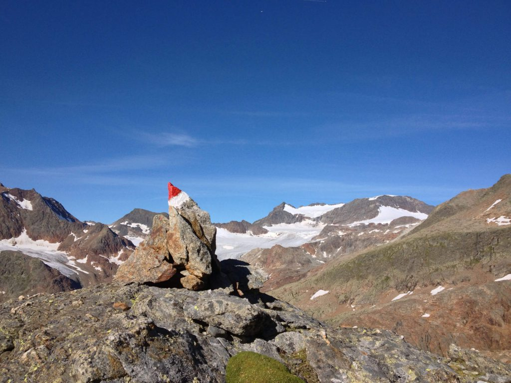 Hiking in South Tyrol - Red-white path marking in the Stubai Alps.