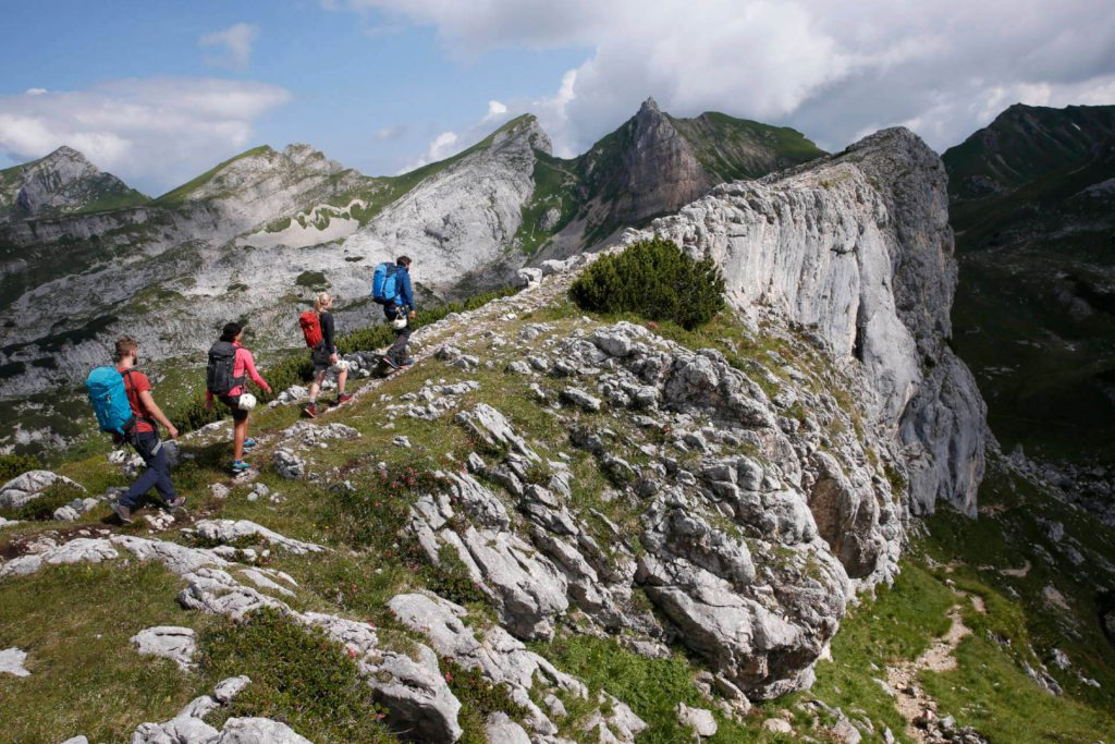 A group of hikers or climbers on their way to a via ferrata.